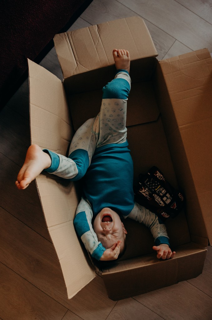 little-boy-crying-inside-a-box-3569879